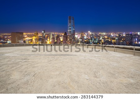 Empty road and modern city skyline - stock photo
