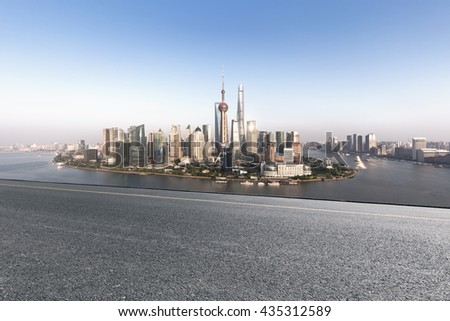 Empty road and modern cityscape of Shanghai - stock photo