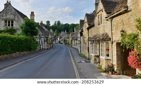 Empty Road and Terraced Cottages in a Beautiful English Village - stock photo