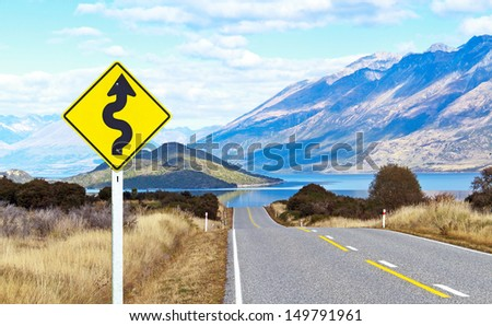 Empty road and traffic sign in landscape view - stock photo
