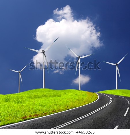 Empty road and windmill - stock photo