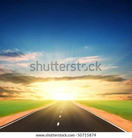 Empty road at sunset. - stock photo