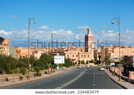 Empty road entering the city of Ouarzazate in east Morocco. The last big city before hitting the Sahara Desert and the boarder with Angelia. - stock photo