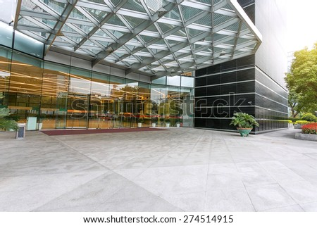 Empty road in front of building entrance - stock photo