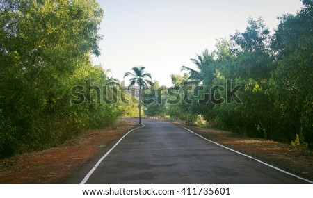 Empty road in Goa India at sunny day - stock photo