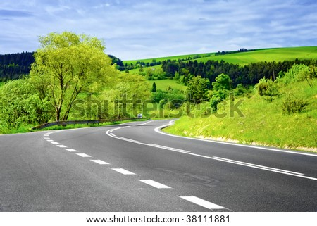 Empty Road in Rural Landscape - stock photo