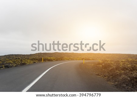 Empty road in sunset - stock photo