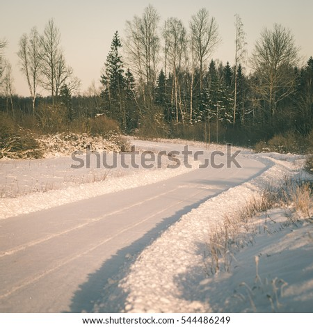 empty road in the countryside with trees in surrounding. perspective in winter - instant vintage square photo
