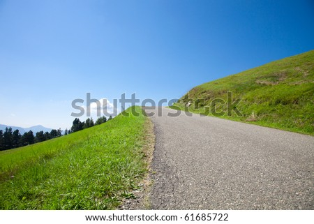 Empty road in the hills - stock photo