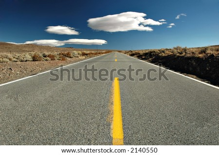 Empty road in the middle of the desert, Eastern Sierra Mountains, California