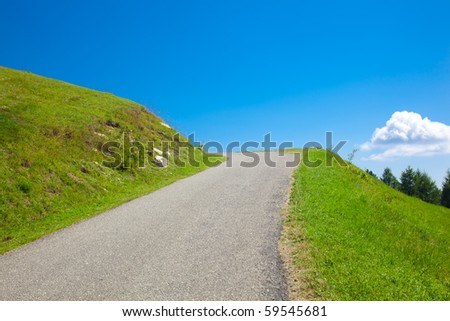 Empty road in the mountains - stock photo
