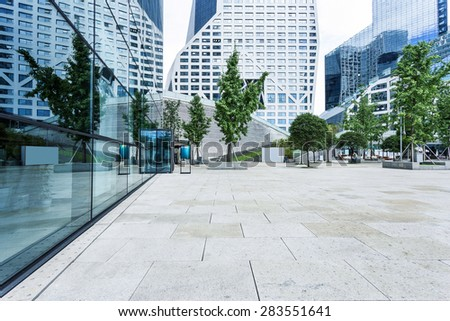 Empty road near modern building - stock photo