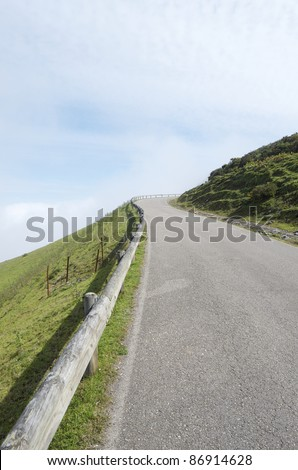 empty road near of  the lakes of Covadonga, National Park Picos de Europa, Asturias, Spain - stock photo
