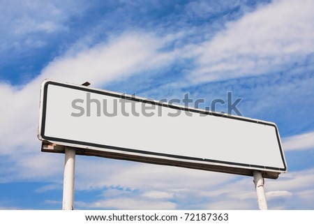 Empty road sign against a background of blue sky with clouds - stock photo