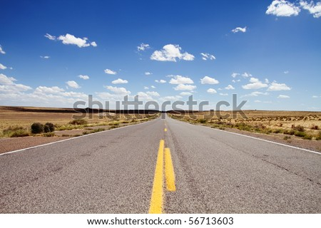 Empty road stretching in Northern New Mexico in USA - stock photo