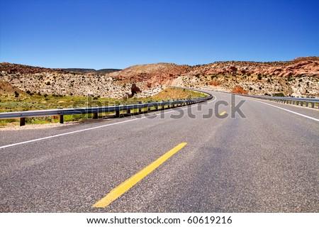Empty road stretching in Utah desert - stock photo
