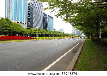 Empty road surface floor freeway with modern city buildings backgrounds in Shenzhen