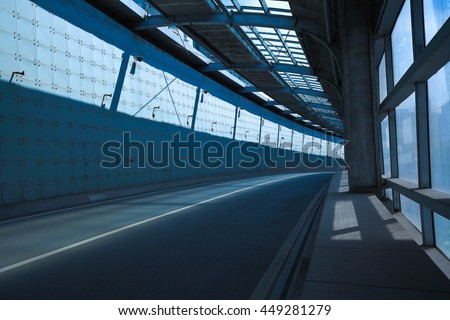 Empty road surface floor in tunnel inside - stock photo