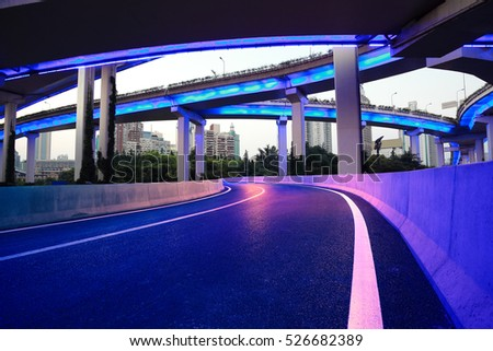 Empty road surface floor with city overpass viaduct bridge of night scene in shanghai