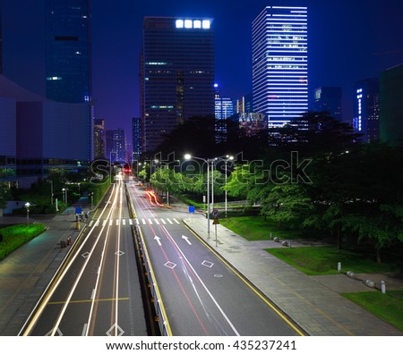 Empty road surface floor with modern city landmark building backgrounds of night scene