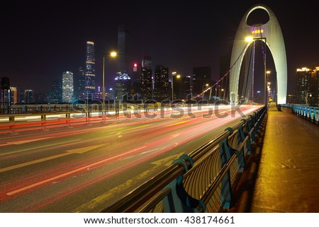 Empty road textured floor at car light trail with  landmark architecture backgrounds of night scene in guangzhou China - stock photo
