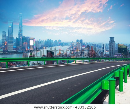 Empty road textured floor with Aerial photography bird-eye view at Shanghai bund Skyline of sunrise  - stock photo