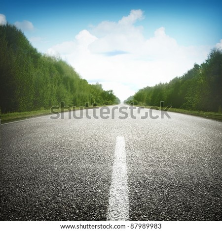 Empty road under blue sky with clouds. - stock photo