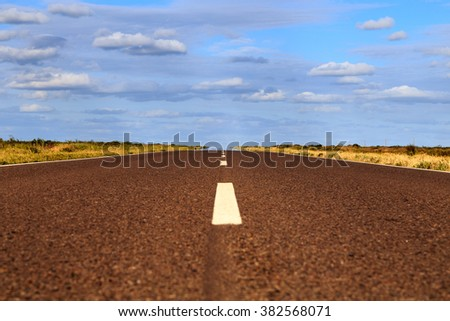 empty road with clouds - stock photo