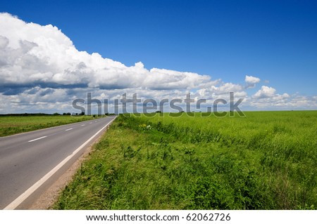 Empty road with clouds above