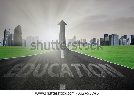 Empty road with Education text turning into arrow upward, symbolizing the way to get better education and bright future - stock photo