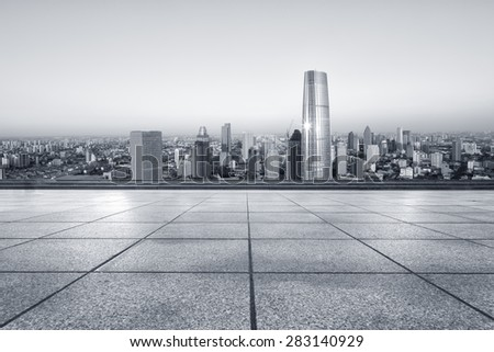 Empty road with modern city skyline - stock photo