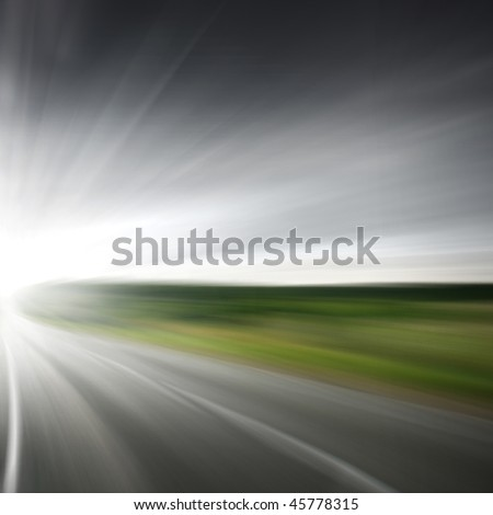 Empty road with motion blur. - stock photo