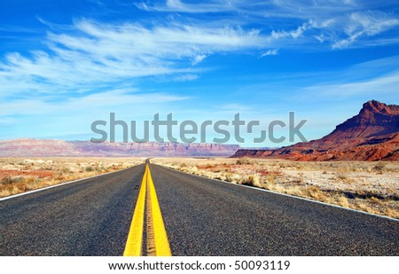 Empty road with mountains behind in Arizona, USA - stock photo