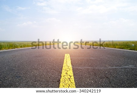 Empty road with slight motion blur - stock photo
