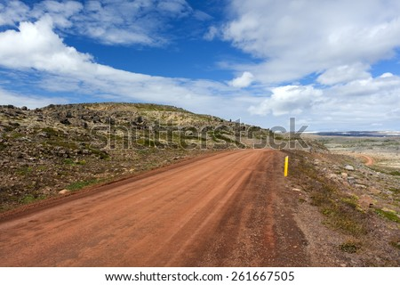 Empty road with sunny cloudy sky in wild Iceland/ Road in Westfjords - stock photo