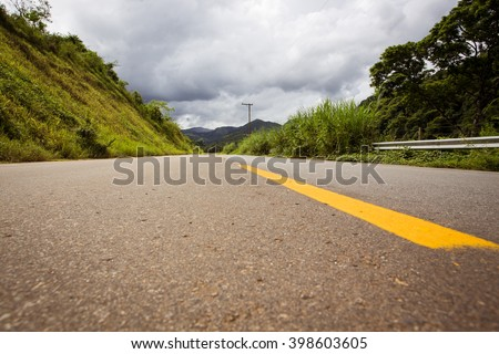 empty road with the beautiful landscapes around at the Brazil - stock photo