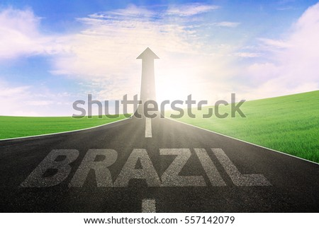 Empty road with word of Brazil and arrow upward at the end of a road