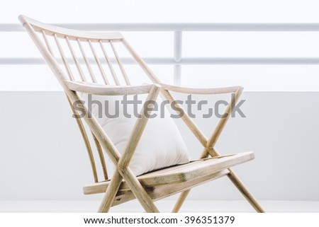 Empty rocking chair decoration in outdoor patio deck - Vintage Light Filter