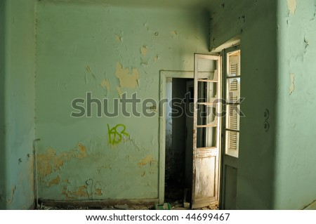Empty room and textured peeling paint wall. Abandoned house interior. - stock photo