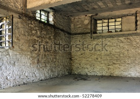 Empty room broken windows and textured white wall. Abandoned factory interior. - stock photo