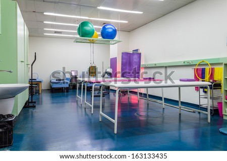 Empty room in physiotherapy clinic - stock photo
