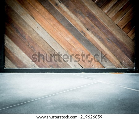 empty room interior,Grunge diagonal wood plank wall and concrete floor - stock photo