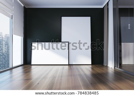 Empty room interior with black walls, a wooden floor, panoramic windows and two framed posters. 3d rendering mock up