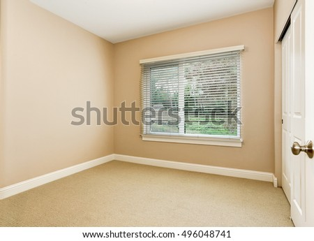 Empty room interior with soft peach walls , carpet floor and window. Northwest, USA