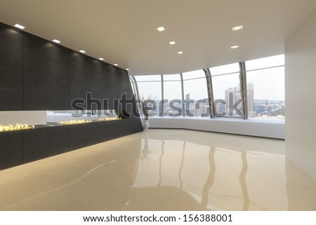 Empty room of a Highrise modern residence with a city background.  - stock photo