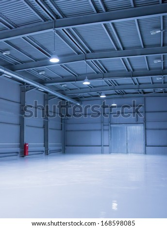 empty room of modern storehouse with gates - stock photo