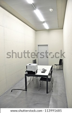 Empty room with a computer on the table - stock photo