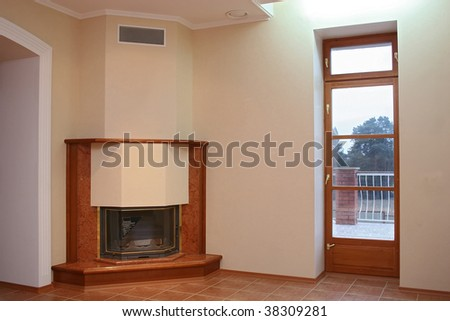 Empty room with a tiled floor, a fireplace and a door on a terrace