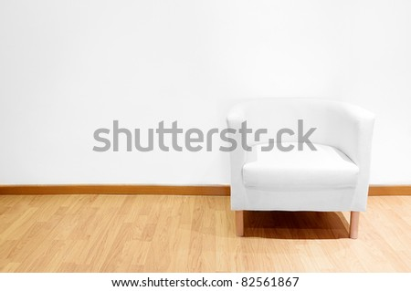 Empty room with a white sofa - stock photo
