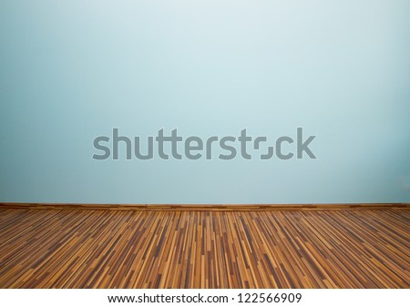 empty room with blue wall and wooden flor - stock photo